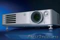 видеопроектор PANASONIC PT AX200E - для бизнеса или домашнего кинотеатра.